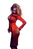Femme chaude d'affaires dans le costume rouge Photographie stock libre de droits