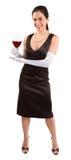 Femme chic de sourire retenant une glace de vin rouge image stock