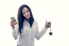 Femme choisissant l'amour d'argent pas, d'isolement sur le blanc Photos stock