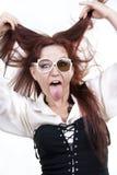 Femme collant à l'extérieur sa langue Photographie stock