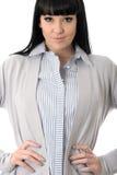 Femme composée autoritaire heureuse sûre avec des mains sur des hanches Photographie stock