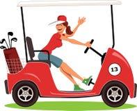 Femme conduisant un chariot de golf Photo stock