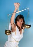 Femme d'échelles ou de Balance images libres de droits