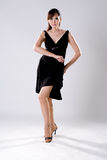 Femme d'élégance dans la pose de danse photographie stock
