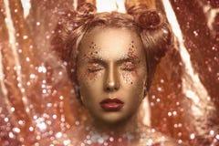 Femme d'or Photographie stock libre de droits