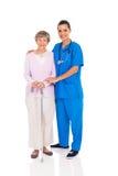 Femme d'aîné d'infirmière Images stock