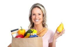 Femme d'achats avec un sac de nourriture Image libre de droits