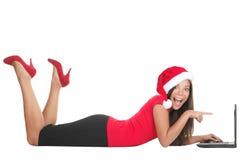Femme d'achats d'Internet de Noël Photographie stock