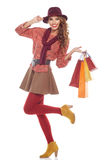 Femme d'achats retenant des sacs, photo stock