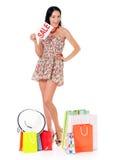 Femme d'achats sur le blanc photographie stock libre de droits