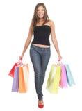 Femme d'achats sur le fond blanc Photos libres de droits