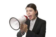 Femme d'affaires à l'aide d'un mégaphone Image stock