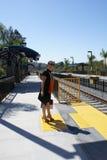 Femme d'affaires à la station de train Images libres de droits