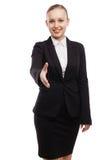 Femme d'affaires étirant la main pour la secousse Photos stock