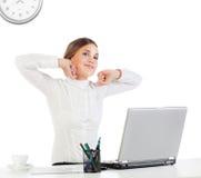 Femme d'affaires étirant ses mains Photos stock