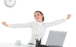Femme d'affaires étirant ses mains Image stock