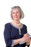Femme d'affaires aînée avec le crayon lecteur Images libres de droits