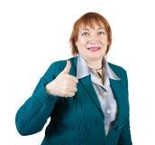 Femme d'affaires aînée avec le pouce vers le haut Photographie stock