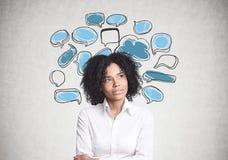 Femme d'affaires d'afro-américain, bulles de la parole Photographie stock