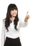 Femme d'affaires appuyant le bouton ou quelque chose. Image stock