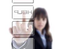 Femme d'affaires appuyant sur le bouton d'aide Photo stock