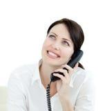 Femme d'affaires attirante au téléphone Photographie stock libre de droits
