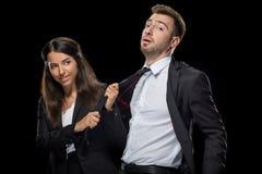 Femme d'affaires attirante flirtant avec son collègue beau Photographie stock libre de droits