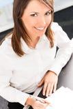 Femme d'affaires au bureau Images libres de droits