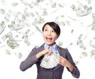 Femme d'affaires avec de l'argent gagné Photographie stock libre de droits