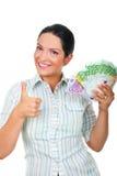 Femme d'affaires avec de l'argent renonçant à des pouces Photo libre de droits
