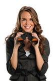 Femme d'affaires avec des jumelles Photo stock