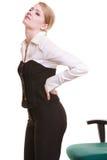Femme d'affaires avec douleurs de dos de mal de dos d'isolement photos libres de droits