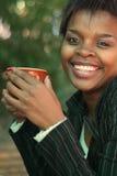 Femme d'affaires avec du café Images stock