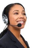 Femme d'affaires avec l'écouteur Photographie stock libre de droits