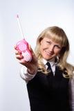 Femme d'affaires avec l'émetteur de rose de jouet Image stock