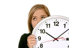 Femme d'affaires avec l'horloge Image stock