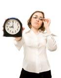 Femme d'affaires avec l'horloge d'alarme (orientation sur l'horloge) Images libres de droits