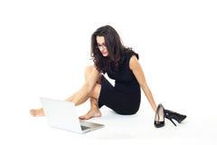 Femme d'affaires avec l'ordinateur portable Photo libre de droits