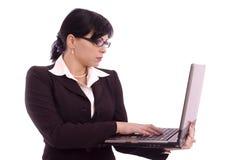 Femme d'affaires avec l'ordinateur portatif Photographie stock
