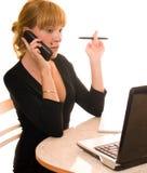 Femme d'affaires avec l'ordinateur portatif et le téléphone Photos libres de droits