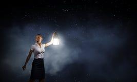 Femme d'affaires avec la lanterne Photos stock
