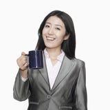Femme d'affaires avec la tasse de café Photographie stock