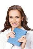 Femme d'affaires avec le bloc-notes, d'isolement images stock