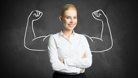 Femme d'affaires avec le dessin symbolisant la puissance Photographie stock