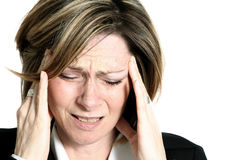 Femme d'affaires avec le mal de tête photo libre de droits