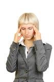 Femme d'affaires avec le mal de tête intense photos libres de droits