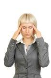 Femme d'affaires avec le mal de tête intense photos stock