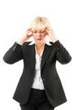 Femme d'affaires avec le mal de tête ou le burn-out Photographie stock libre de droits