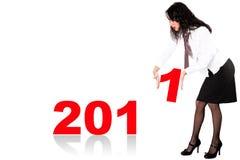 Femme d'affaires avec le mot 2011 Photo stock