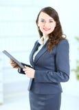 Femme d'affaires avec le plan de travail Photo stock